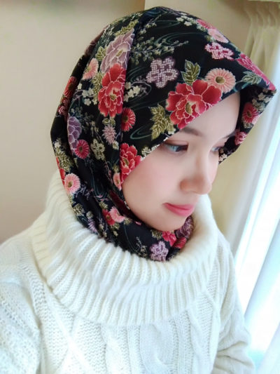 Put the low part of hijab to the turtle neck or simply tie both tips behind the neck